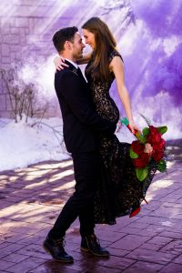 couple using purple smoke for engagement pictures