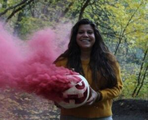 Halloween picture with pumpkin and pink smoke bomb